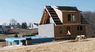 A home mid-way through construction in the early years of Shadowlake Village.