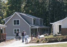 Neighbors come together in a nearly-finished Shadowlake Village community before the last landscaping is finished on the final-few homes.